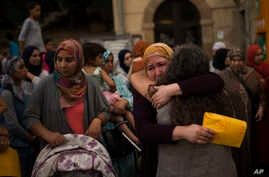 Members of the local Muslim community gather along with relatives of young men believed responsible for the attacks in Barcelona and Cambrils to denounce terrorism and show their grief in Ripoll, north of Barcelona, Spain, Aug. 20, 2017.