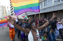 A woman holds her hands up during the Durban Pride parade where several hundred people marched through the city center in support of gay rights, July 30, 2011 file photo.