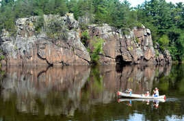 Visitors canoe and kayak on the Saint Croix River in Minnesota.