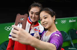 Lee Eun-Ju (KOR) of South Korea (R) takes a selfie picture with Hong Un Jong (PRK) of North Korea.