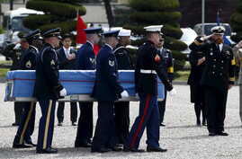 Members of the United Nations Command honor guards carry boxes containing the remains of a United Nations Command soldier who was killed inside North Korea in the 1950-53 Korean War, during a jointly held repatriation ceremony at Knight Field in Seou