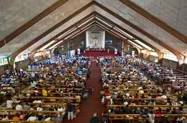 FILE - A mass in memory of Nelson Mandela takes place at the Regina Mundi church in Soweto, Johannesburg, South Africa, Dec. 2013.