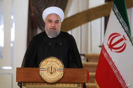 In this photo released by his office, Iranian President Hassan Rouhani addresses his nation in a televised speech, in Tehran, Oct. 13, 2017. Rouhani spoke after U.S. President Donald Trump angrily accused Iran of violating the spirit of the 2015 nucl