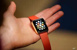 A woman holds the Apple Watch Edition during a demo following an Apple event Monday, March 9, 2015.