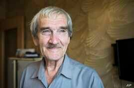 """FILE - Former Soviet missile defense forces officer Stanislav Petrov poses for a photo at his home in Fryazino, Moscow region, Russia, Aug. 27, 2015. Petrov, a former Soviet military officer known in the West as """"The man who saved the world'' for his"""