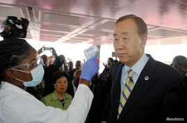 U.N. Secretary General Ban Ki-moon has his temperature checked upon arrival at the Roberts International airport in Liberia's capital Monrovia, Dec. 19, 2014.