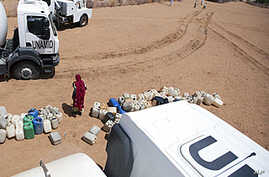 The distribution of 40,000 liters of water is seen among the local community in El Srief, North Darfur, July 25, 2011