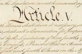 This photo made available by the U.S. National Archives shows a portion of the United States Constitution with the title of Article V. For the past two centuries, constitutional amendments have originated in Congress, where they need the support of t