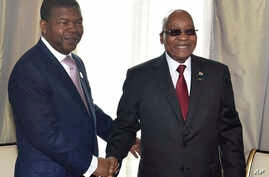 In this photo supplied by South African Communication and Information Services (GCIS), Angolan President Joao Lourenco, left, and his South African counterpart Jacob Zuma, meet in Luanda, Angola, Nov. 21 2017.