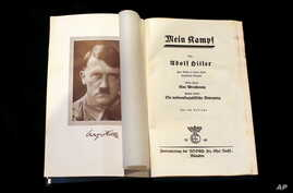 """A copy of Adolf Hitler's """"Mein Kampf"""" from 1940 is pictured in Berlin, Dec. 16, 2015."""