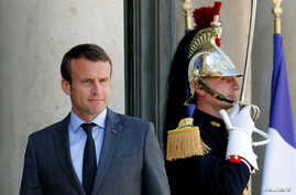 French President Emmanuel Macron waits for guests to leave at the Elysee Palace in Paris, France, June 6, 2017.