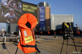 Lifejackets are pictured in front of the European Commission headquarters during a protest by Amnesty International to demand the European Council protect the human rights of the refugees within the EU-Turkey migration deal, ahead of an EU summit ove