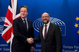 British Prime Minister David Cameron, left, is greeted by European Parliament President Martin Schultz at the European Parliament in Brussels, Belgium, Feb. 16, 2016.