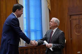 Attorney General Jeff Sessions, left, shakes hands with FBI Director James Comey, left, at the start of a meeting with the heads of federal law enforcement components at the Department of Justice in Washington, Feb. 9, 2017.