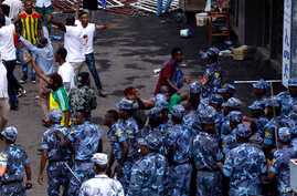 FILE - Ethiopian security forces intervene on Meskel Square in Addis Ababa on June 23, 2018, where a blast killed several people during a rally led by Prime Minister Abiy Ahmed.
