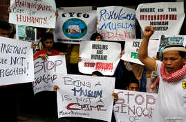 Filipino Muslims display placards during a rally to protest Myanmar's persecution of Rohingya Muslims outside Myanmar's embassy in Makati, Metro Manila, Philippines, Sept. 8, 2017.