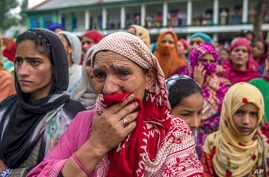 Kashmiri women grieve as they watch funeral of Showkat Ahmed Lohar, a local militant in Arwani, about 55 kilometesr (35 miles) south of Srinagar, India, July 18, 2017. Indian soldiers and police killed three suspected rebels during a brief gun battle