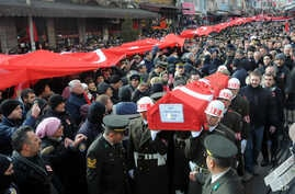 People carry the coffin after funeral prayers for Turkish soldier Goktan Ozupekin, who was killed with 15 others by IS militants in al-Bab, Syria, in Kirklareli , Turkey, Friday, Dec. 23, 2016.
