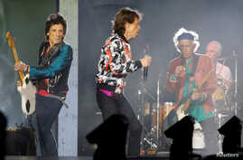 """FILE - Mick Jagger, Keith Richards, Ron Wood and Charlie Watts of the Rolling Stones perform during a concert of their """"No Filter"""" European tour at the Orange Velodrome stadium in Marseille, France, June 26, 2018."""