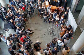 Members of the media gather at the parliamentary inquiry investigating the NSA's activities in Germany, in Berlin, May 7, 2015.