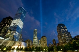 The Tribute in Light rises behind buildings adjacent to the World Trade Center in New York, Sept. 8, 2014.