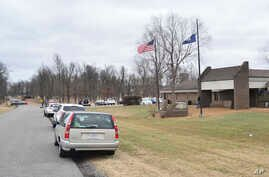 Authorities investigate the scene of school shooting, Tuesday, Jan 23, 2018, in Benton, Ky. Kentucky State Police said the suspect was apprehended by a Marshall County deputy.