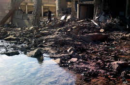 A suicide attacker detonates a car bomb at a Syrian security compound in a remote, predominantly Kurdish area, killing at least four people in the latest sign that Syria's largest ethnic minority is increasingly being drawn into a widening civil war,