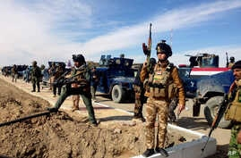 FILE - Iraqi Security forces preparing to attack al-Qaida positions in Ramadi, 70 miles (115 kilometers) west of Baghdad, Iraq.  Militants, many from the al-Qaida-breakaway group Islamic State in Iraq and the Levant, overran Fallujah and parts of Anb