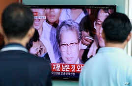 The image of Yoo Byung-eun, owner of the sunken ferry, on a television at the Seoul Railway Station in South Korea, July 22, 2014. Police say a badly decomposed body found in a field last month was that of the fugitive billionaire blamed for April's