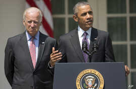 President Barack Obama, accompanied by Vice President Joe Biden, speaks in the Rose Garden of the White House in Washington, July 1, 2015.
