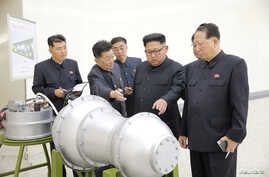 North Korean leader Kim Jong Un, center, provides guidance on a nuclear weapons program in this undated photo released by North Korea's Korean Central News Agency (KCNA) in Pyongyang, Sept. 3, 2017.  KCNA via REUTERS