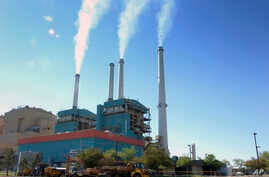FILE - Smoke rises from the Colstrip Steam Electric Station, a coal-burning power plant in Colstrip, Mont., July 1, 2013.
