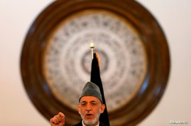 Outgoing Afghan President Hamid Karzai speaks during a gathering of government employees in Kabul, Afghanistan, Sept. 23, 2014.