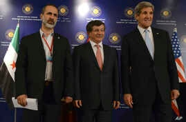 "U.S. Secretary of State John Kerry, right, Turkish Foreign Minister Ahmet Davutoglu, center, and Syrian opposition leader Moaz al-Khatib pose for photos after a ""Friends of Syria"" group meeting at the Adile Sultan Palace, April 21, 2013, in Istanbul,"
