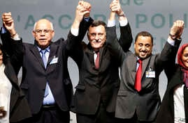L-R, Mohammed Chouaib, head of delegation from the U.N.-recognized government in the eastern city of Tobruk, Libya, Fayez Sarraj, Libyan prime minister, and Dr. Saleh Almkhozom, second deputy chairman of the Libyan General National Congress, react af...