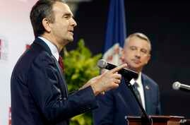 Democratic candidate for governor, Lt. Gov. Ralph Northam, left, gestures during a debate with Republican challenger Ed Gillespie at the University of Virginia-Wise in Wise, Va., Oct. 9, 2017.