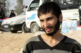 Yazan Abdulrahman Mohammad Ali, 20, escaped from Raqqa less than two weeks ago and was detained for ten days before being freed.  But his family is dead, and his home is destroyed on Oct. 25, 2017 in Ain Issa, Syria. (H.Murdock/VOA)