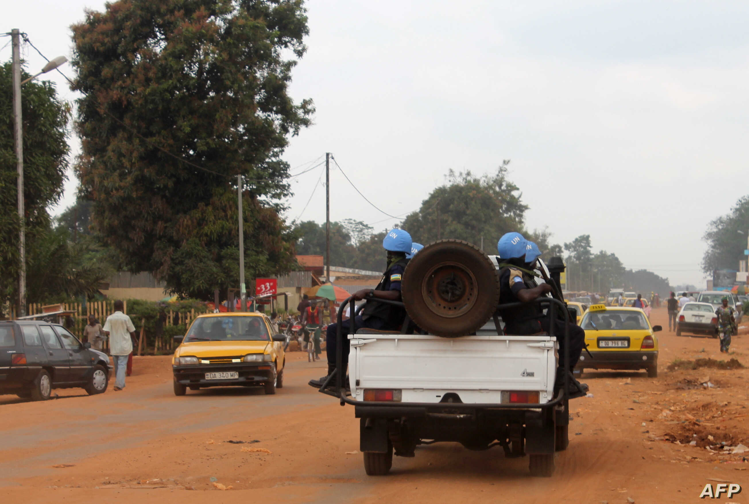 FILE - Soldiers of the U.N. force known by its French acronym MINUSCA are seen sitting on a vehicle in Bangui, Central African Republic.