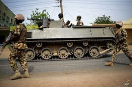 Nigerian troops patrol in the northeastern Nigeria city of Mubi — recaptured from Boko Haram in February — 20 kilometers (14 miles) west of the Cameroon border, March 9, 2015.