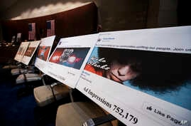 FILE - Facebook ads linked to a Russian effort to disrupt the American political process are displayed as Google, Facebook and Twitter officials testify during a House Intelligence Committee hearing on Capitol Hill in Washington, Nov. 1, 2017.