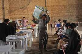 Afghan election commission worker unloads ballot boxes in Herat Province, west of Kabul, April 20, 2014.