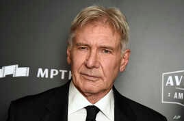In this Nov. 5, 2017, file photo, Harrison Ford, who plays Indiana Jones in the movie series,  poses in the press room at the Hollywood Film Awards at the Beverly Hilton hotel in Beverly Hills, Calif.