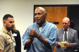Former pro football star O.J. Simpson reacts after learning he was granted parole at Lovelock Correctional Center in Lovelock, Nev.,  July 20, 2017.
