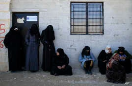 Women standing outside the Free Legal Support Program office in the shelter in Jibreen, Syria, Jan. 21, 2017.