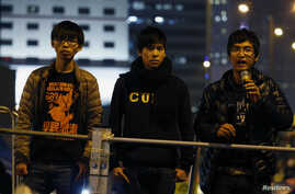 Student leaders Joshua Wong (L-R), Lester Shum and Alex Chow attend a rally at the Occupy Central protest site outside the Legislative Council at Admiralty in Hong Kong December 10, 2014. Hong Kong urged pro-democracy protesters to pack up their tent