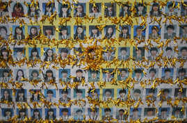 Portraits of students who died in the mid-April Sewol ferry disaster, decorated by yellow ribbons dedicated to the victims, are pictured in central Seoul, October 27, 2014.