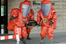 epa05298871 Tokyo Fire Department special rescue unit members wearing special anti-NBC (Nuclear, Biological, and Chemical weapons) suits during an anti-terrorism drill in preparation for the upcoming Group of Seven Ise-Shima Summit at Shima Kanko hot