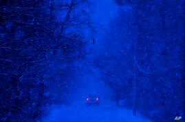 A motorist drives through a snow storm in Durham, Maine, Thursday, Dec. 29, 2016. A nor'easter is expected to drop 12 to 18 inches of snow on parts of Maine.