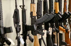 FILE - Various models of semi-automatic rifles are displayed at a store in Pennsylvania, March 1, 2018.