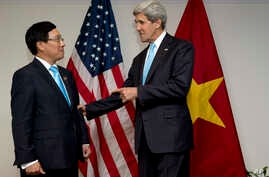 U.S. Secretary of State John Kerry, right, meets with Vietnam's Foreign Minister Pham Binh Minh during ASEAN meetings in Bandar Seri Begawan, Brunei on Tuesday, July 2, 2013. Kerry is expected to start the return to Washington Tuesday afternoon. (AP